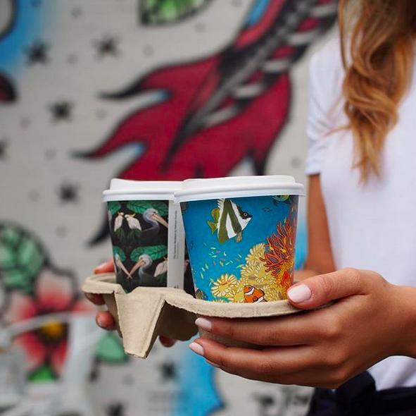 Una tazza ecologica di arte, grazie!